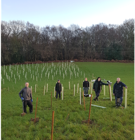 Volunteers planting trees to slow surface water © Sussex Flow Initiative